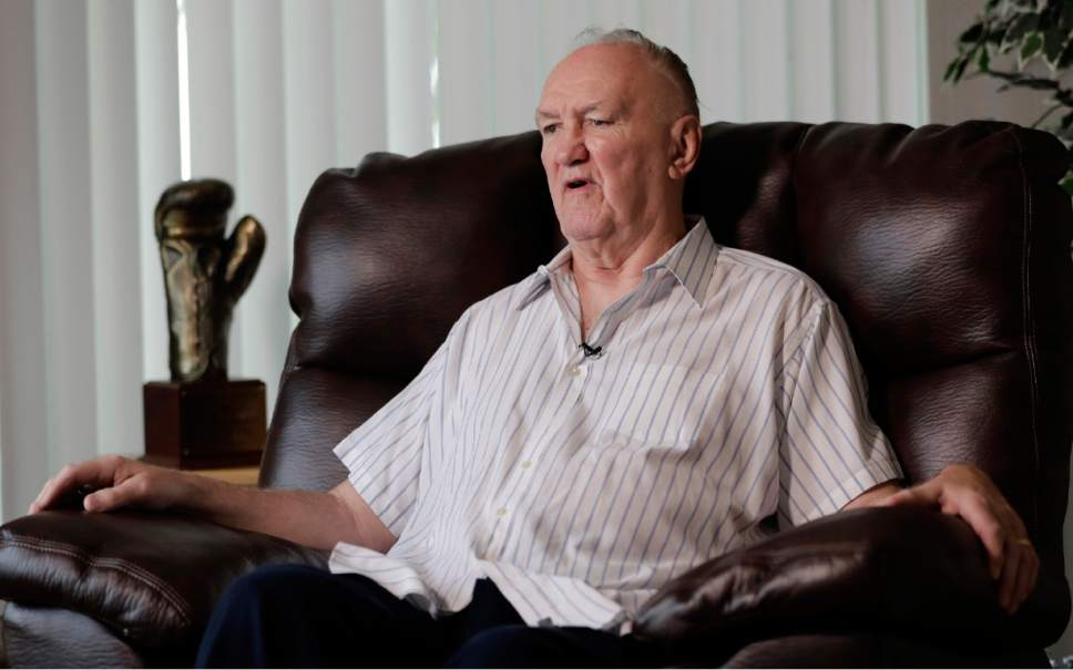 """In a photo taken Wednesday, April 26, 2017, former boxer Chuck Wepner talks to The Associated Press in his home in Bayonne, N.J. Forty-two years after he stepped into the ring against Muhammad Ali as a 40-to-1 underdog, Wepner's business card still has a picture of the moment when he knocked down the champ. Wepner's life story has now arrived on the big screen with Liev Schreiber playing the Bayonne Bleeder in """"Chuck,"""" which opens on Friday, May 5, 2017, in New York and Los Angeles before expanding nationwide. (AP Photo/Julio Cortez)"""