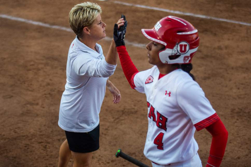 Chris Detrick  |  The Salt Lake Tribune University of Utah softball coach Amy Hogue high fives Delilah Pacheco during the game against Washington Thursday, May 11, 2017.