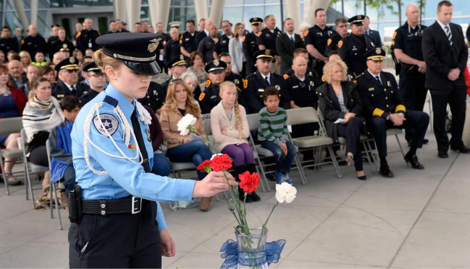 Al Hartmann  |  The Salt Lake Tribune Members of the Salt Lake City Explorers placed a single flower at sunrise service Tuesday May 16 to honor and pay tribute to 25 Salt Lake City's fallen police officers over the years.