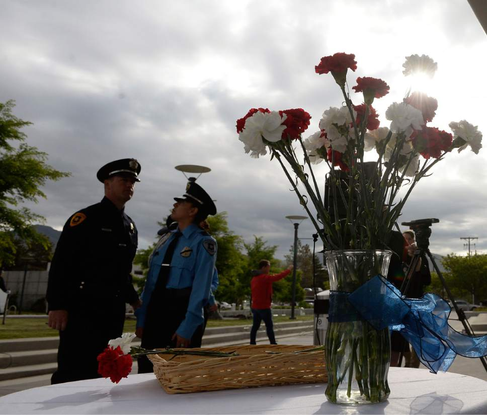 Al Hartmann  |  The Salt Lake Tribune Single flowers were placed in a vase at sunrise service Tuesday May 16 that honored and payed tribute to 25 Salt Lake City's fallen police officers over the years.