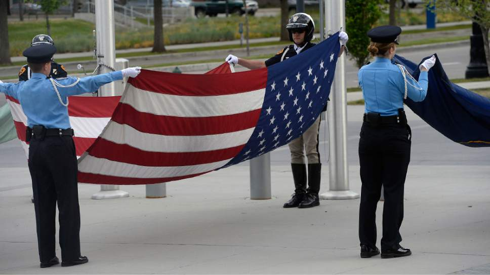 Al Hartmann  |  The Salt Lake Tribune  Salt Lake City Police officers raised the American, Utah State, and Salt Lake City flags at sunrise service Tuesday May 16 that honored and payed tribute to 25 Salt Lake City's fallen police officers over the years.