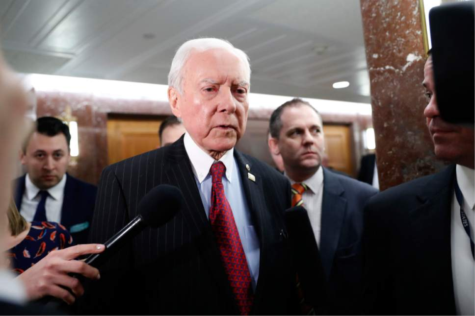 Alex Brandon     AP file photo Sen. Orrin Hatch, R-Utah, center, Jan. 31, 2017, on Capitol Hill in Washington. Hatch says President Trump's sharing of classified information with Russians has been blown out of proportion.