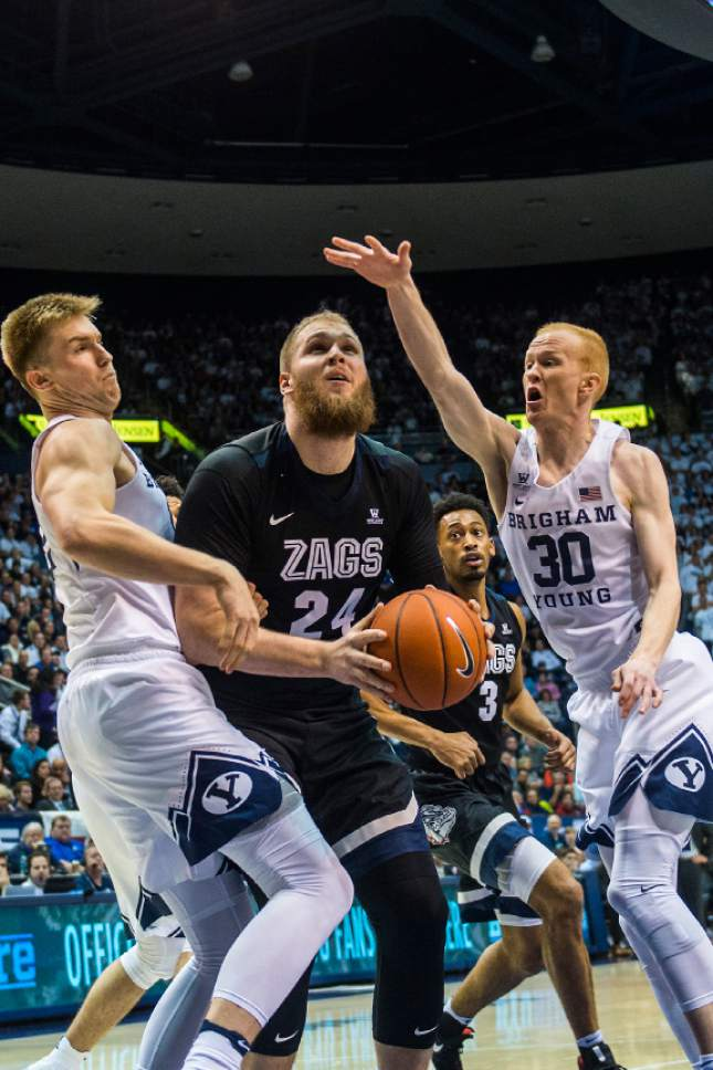 Chris Detrick  |  The Salt Lake Tribune Brigham Young Cougars forward Eric Mika (12) and Brigham Young Cougars guard TJ Haws (30) guard Gonzaga Bulldogs center Przemek Karnowski (24) during the game at the Marriott Center Thursday February 2, 2017.