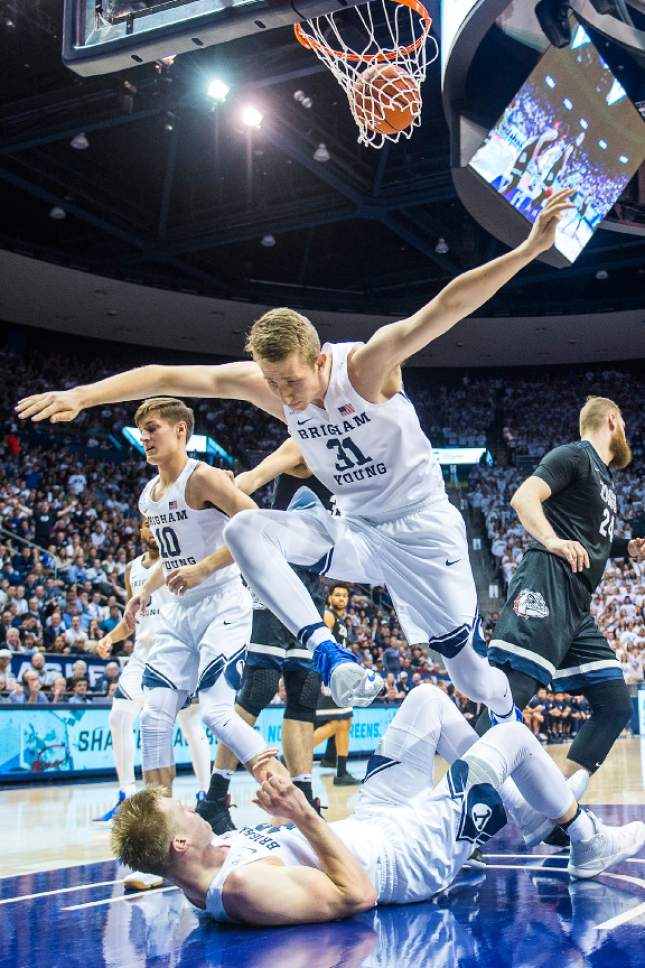 Chris Detrick  |  The Salt Lake Tribune Brigham Young Cougars forward Braiden Shaw (31) jumps over Brigham Young Cougars forward Eric Mika (12) during the game at the Marriott Center Thursday February 2, 2017.