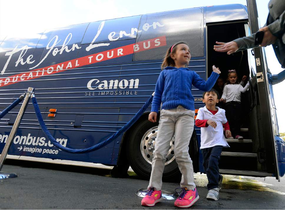Al Hartmann  |  The Salt Lake Tribune Jackson Elementary kindergartners get high fives after touring the John Lennon Educational Tour Bus Wednesday May 17.  It's a  state-of-the-art mobile audio, video and live production facility.  In its 20th year, with the very newest technology and gear, the bus provides young people with career development tours of the studios and offers free digital media production workshops. In the workshops, assisted by three on-board engineers, students learn how to write, record, and produce original songs, music videos, documentaries, and live multi-camera video productions, using the most up-to-date  IT Solutions .