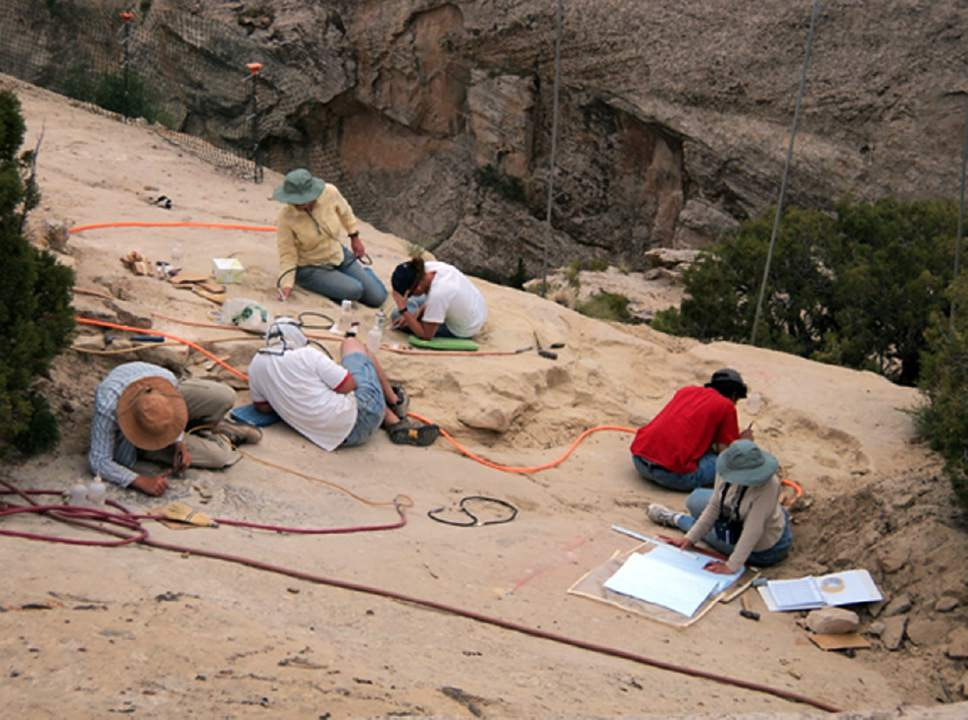 In this undated photo provided by Brigham Young University on Oct. 16, 2015, paleontologists work at a site where a pterosaur, which would have been the largest flying reptile of the time some 210 million years ago, was found in 2009, in Dinosaur National Monument near the town of Jensen in northeastern Utah.  (Brooks Britt/Brigham Young University via AP)