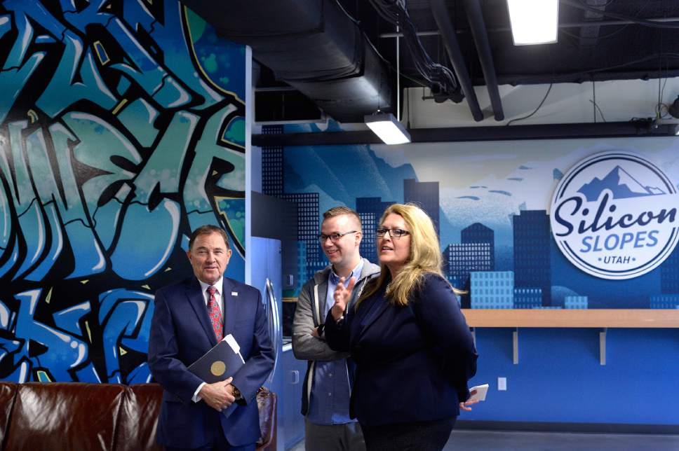 Scott Sommerdorf  |  The Salt Lake Tribune Utah Gov. Gary Herbert, speaks with Silicon Slopes Executive Director Clint Betts, center, and Silicon Slopes board member Carine Clark as they show him around the new Silicon Slopes space in Lehi on Wednesday.