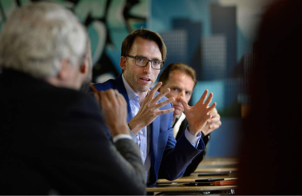 Scott Sommerdorf | The Salt Lake Tribune Brad Rencher, exec VP of Adobe in Utah, asks Utah Gov. Gary Herbert, and Lt. Gov. Spencer Cox a question about the diversity, planning, and transportation. He, along with other tech executives met with Herbert and Cox prior to a ribbon cutting ceremony at Silicon Slopes, the organization that promotes the growth of high tech business in Utah, which opened a new headquarters in Lehi, Wednesday, May 17, 2017.