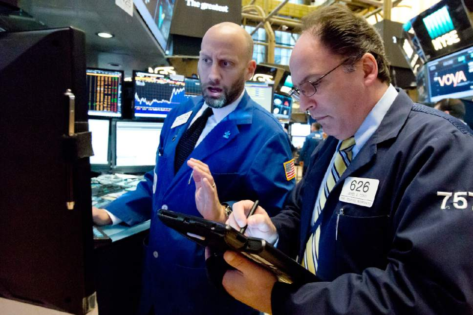 Specialist Meric Greenbaum, left, and trader James Conti work on the floor of the New York Stock Exchange, Wednesday, May 17, 2017. Stocks are opening lower on Wall Street as banks and industrial companies fall. (AP Photo/Richard Drew)