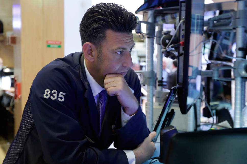 Trader Glenn Kessler works on the floor of the New York Stock Exchange, Wednesday, May 17, 2017. Stocks are opening lower on Wall Street as banks and industrial companies fall. (AP Photo/Richard Drew)