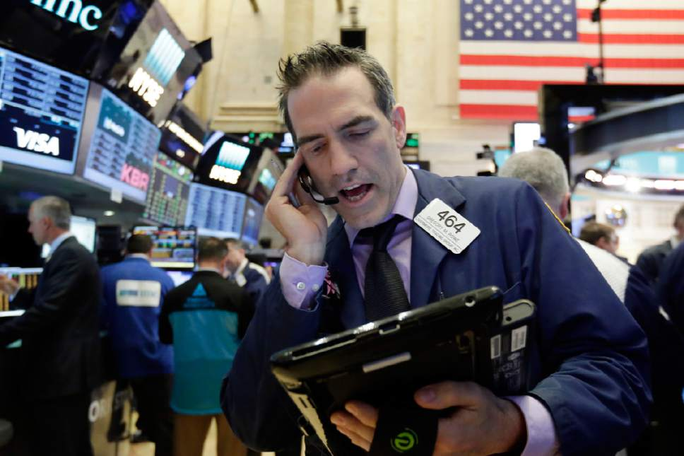 Trader Gregory Rowe works on the floor of the New York Stock Exchange, Wednesday, May 17, 2017. Stocks are opening lower on Wall Street as banks and industrial companies fall. (AP Photo/Richard Drew)