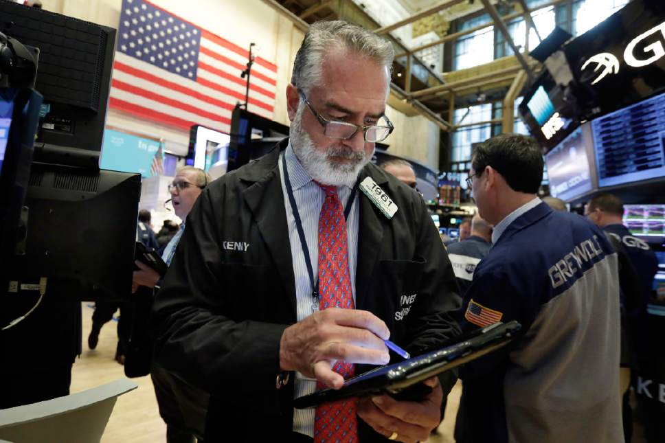 Trader Kenneth Polcari works on the floor of the New York Stock Exchange, Wednesday, May 17, 2017. Stocks are opening lower on Wall Street as banks and industrial companies fall. (AP Photo/Richard Drew)