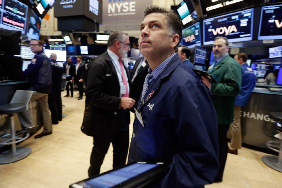 Trader Jeffrey Lucchesi works on the floor of the New York Stock Exchange, Wednesday, May 17, 2017. Stocks are opening lower on Wall Street as banks and industrial companies fall. (AP Photo/Richard Drew)