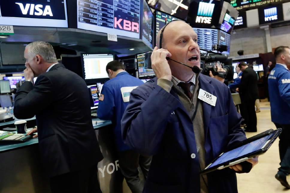 Trader Daniel Leporin, right, works on the floor of the New York Stock Exchange, Wednesday, May 17, 2017. Stocks are opening lower on Wall Street as banks and industrial companies fall. (AP Photo/Richard Drew)