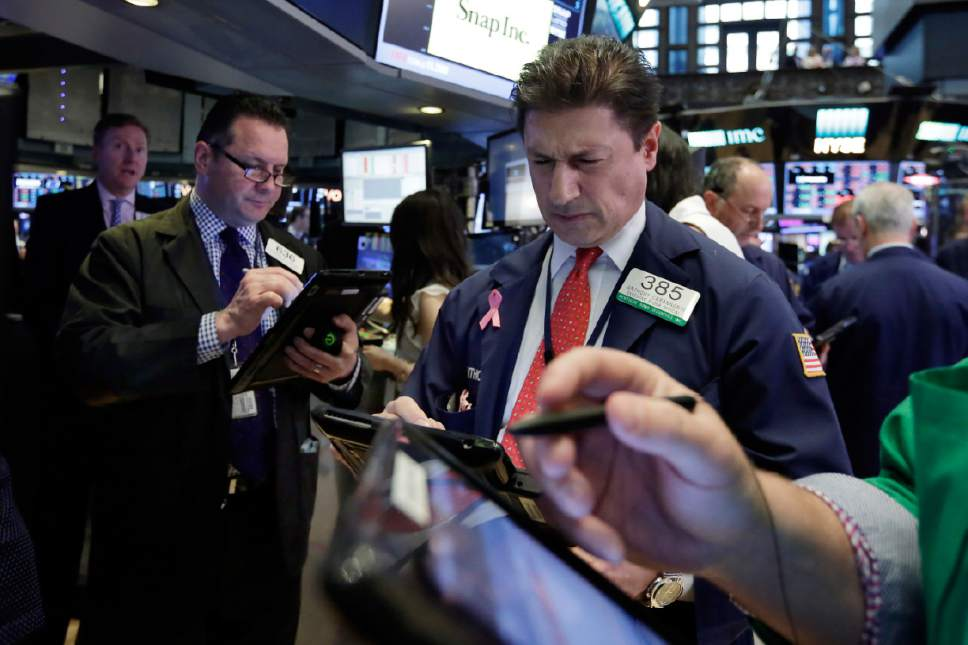Trader Anthony Carannante, center, works on the floor of the New York Stock Exchange, Wednesday, May 17, 2017. Stocks are opening lower on Wall Street as banks and industrial companies fall. (AP Photo/Richard Drew)