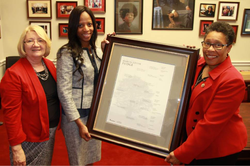 Courtesy of The Church of Jesus Christ of Latter-day Saints Ohio Congresswoman Marcia L. Fudge, right, receives a copy of her family history from FamilySearch researcher Carol Smith, left, and Utah Congresswoman Mia Lovein Washington, D.C., on Tuesday.