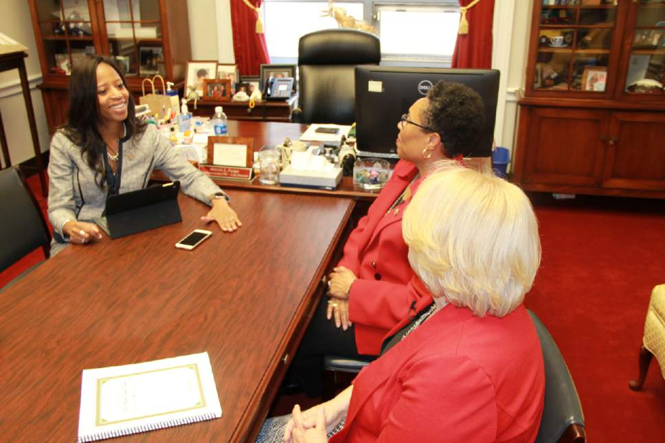 |  Courtesy of The Church of Jesus Christ of Latter-day Saints  Utah Representative Mia Love visits with Ohio Representative Marcia Fudge and FamilySearch researcher Carol Smith in Washington, D.C., May 2, 2017. Rep. Fudge received a copy of her family history from FamilySearch, sponsored by The Church of Jesus Christ of Latter-day Saints.