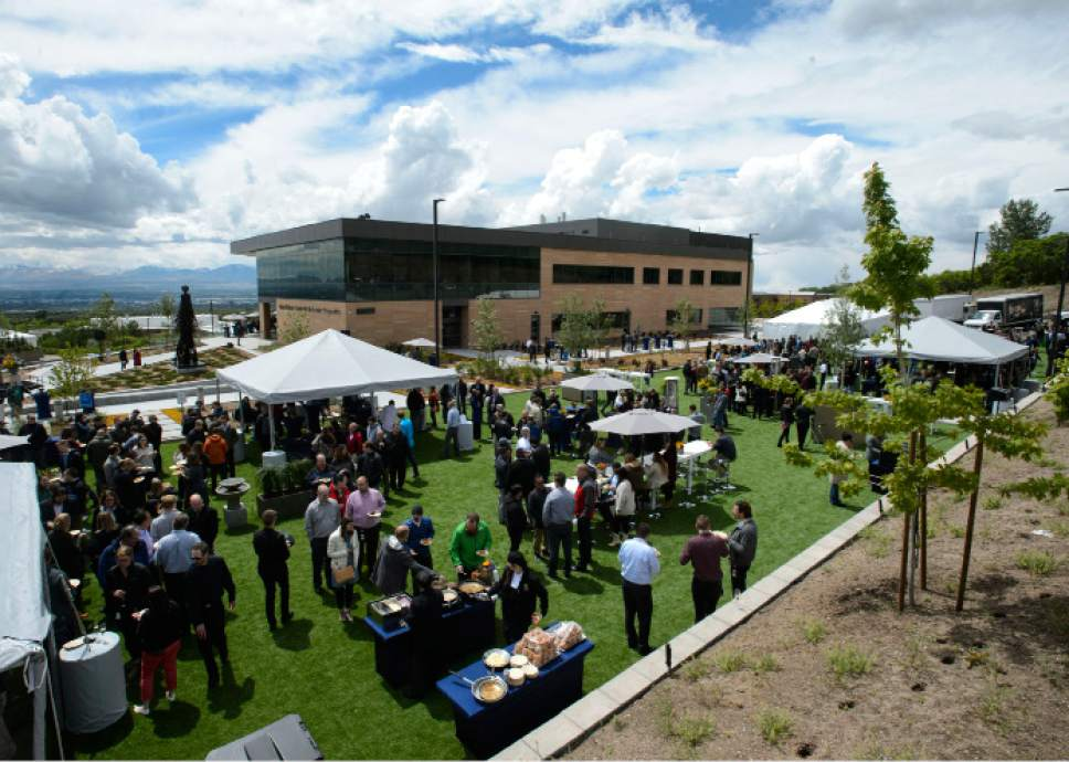 Steve Griffin  |  The Salt Lake Tribune More than 850 BioFire employees, local dignitaries and building contractors celebrate the opening of BioFire Diagnostics, LLC at their new home in Research Park in Salt Lake City on Wednesday.