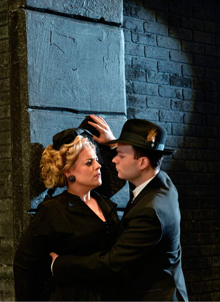 "Scott Sommerdorf | The Salt Lake Tribune Melinda Whittington (Donna Anna), with Joshua Hopkins (Don Giovanni), in Utah Opera's film-noir-inspired production of Mozart's ""Don Giovanni."""