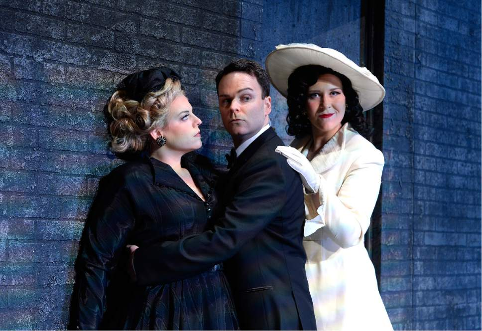 "Scott Sommerdorf | The Salt Lake Tribune Melinda Whittington (Donna Anna), left, with Joshua Hopkins (Don Giovanni), and Caitlin Lynch (Donna Elvira) in Utah Opera's film-noir-inspired production of Mozart's ""Don Giovanni."""