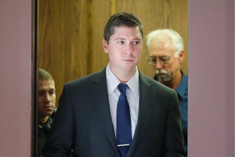 FILE- In this July 19, 2015, file photo, Ray Tensing arrives at court on the fourth day of jury deliberations in his murder trial, in Cincinnati. Prosecutors in Ohio say a T-shirt with a Confederate flag emblem worn by Tensing, a white police officer, under his uniform is relevant evidence for countering his claim that he feared for his life when he shot Sam DuBose, an unarmed black motorist. The defense says the T-shirt isn't relevant, but could prejudice the jury. (AP Photo/John Minchillo, File)