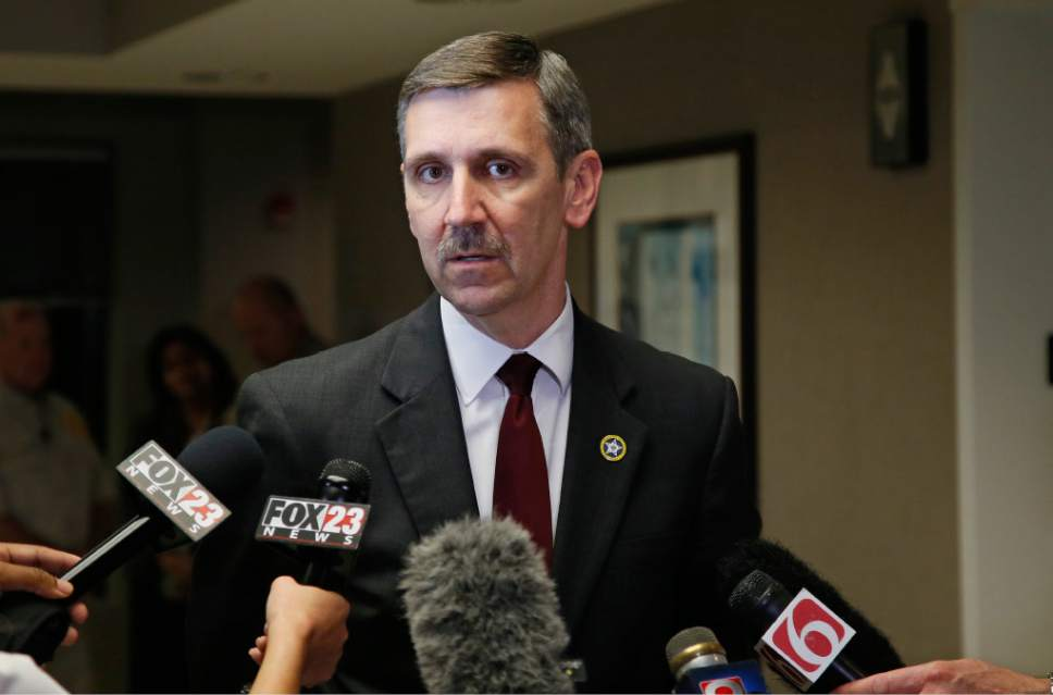 Steve Kunzweiler, Tulsa County District Attorney, talks with the media following a verdict in the trial of  Tulsa police officer Betty Jo Shelby in Tulsa, Okla., Wednesday, May 17, 2017. Shelby was charged with  first-degree manslaughter in the fatal shooting of Terence Crutcher, an unarmed black man. Shelby was found not guilty. (AP Photo/Sue Ogrocki)