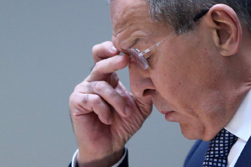 Russian foreign minister Sergey Lavrov adjust his glasses during a press conference after a meeting with his Cyprus counterpart Ioannis Kasoulides at the foreign ministry in capital Nicosia, Cyprus, on Thursday, May 18, 2017. Lavrov is in Cyprus for two-day working visit. (AP Photo/Petros Karadjias)
