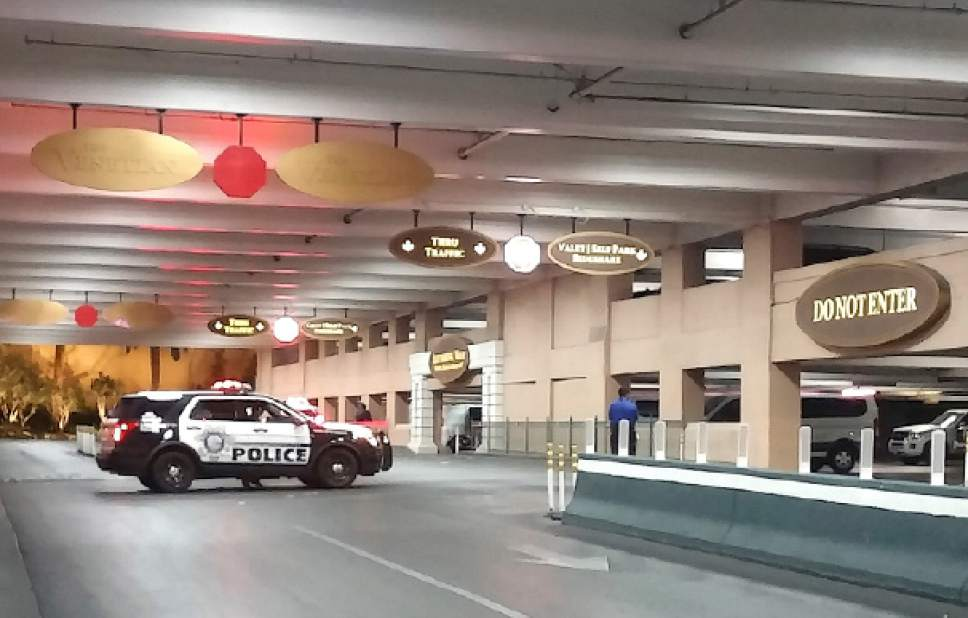 """This photo taken at The Venetian Hotel and Casino in Las Vegas on Sunday, March 14, 2017, shows the scene where an unarmed man died after police squeezed his neck during a struggle to subdue him. The American Civil Liberties Union of Nevada, which led a push for use-of-force reforms after Las Vegas police were involved in 25 shootings in 2010, said Monday, May 15, 2017, that it will seek a review of the training that allows officers to use what the department calls """"lateral vascular neck restrain."""" (Billy Winkler via AP)"""