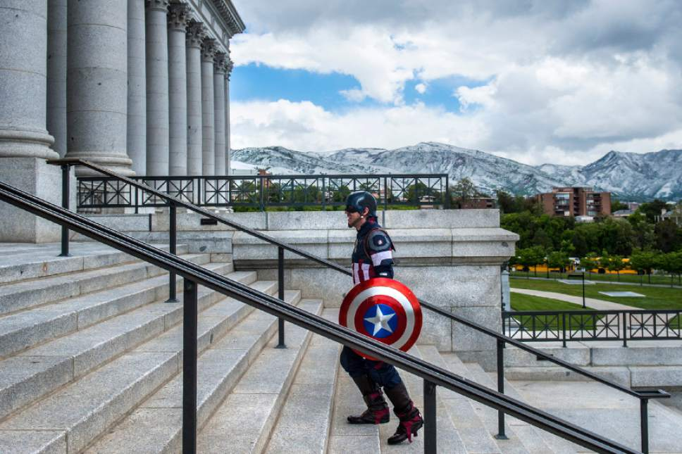 Chris Detrick  |  The Salt Lake Tribune Captain American, D.J. Halladay, of Salt Lake City, walks up the stairs to the Utah State Capitol after a press conference for Salt Lake Comic Con Wednesday, May 17, 2017.