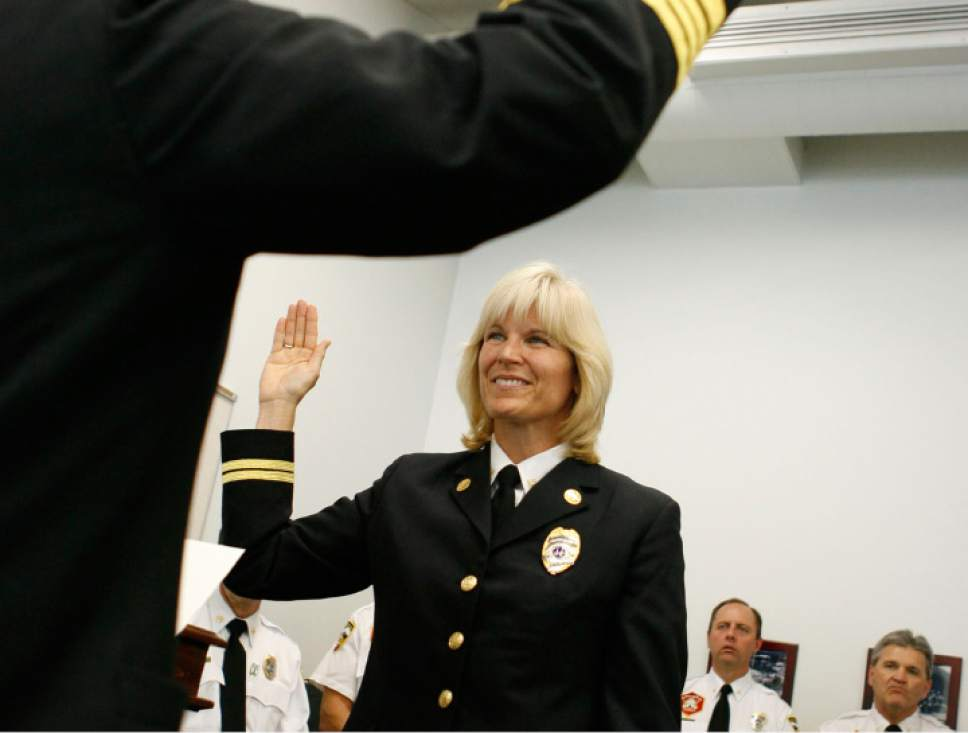 Francisco Kjolseth | Tribune file photo  Martha Ellis is sworn in after being promoted to the rank of division chief for Salt Lake City, becoming the Salt Lake City Fire Department's first female fire marshall on May 7, 2009. Ellis has filed a lawsuit, alleging fraud, fire code violations and cover-ups at SLC Fire Department.