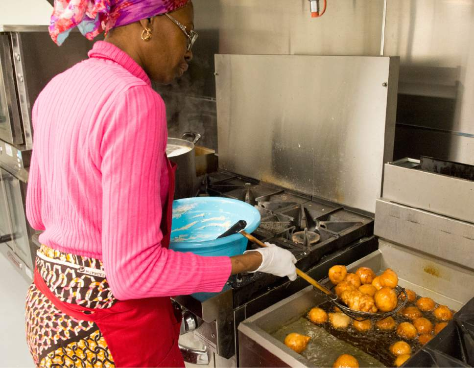 Rick Egan  |  The Salt Lake Tribune  Cathy Tshilombo, owner of Mama Africa Kitoko, seen here in 2015, is one of 17 food vendors at the 2017 Living Traditions Festival in Salt Lake City.