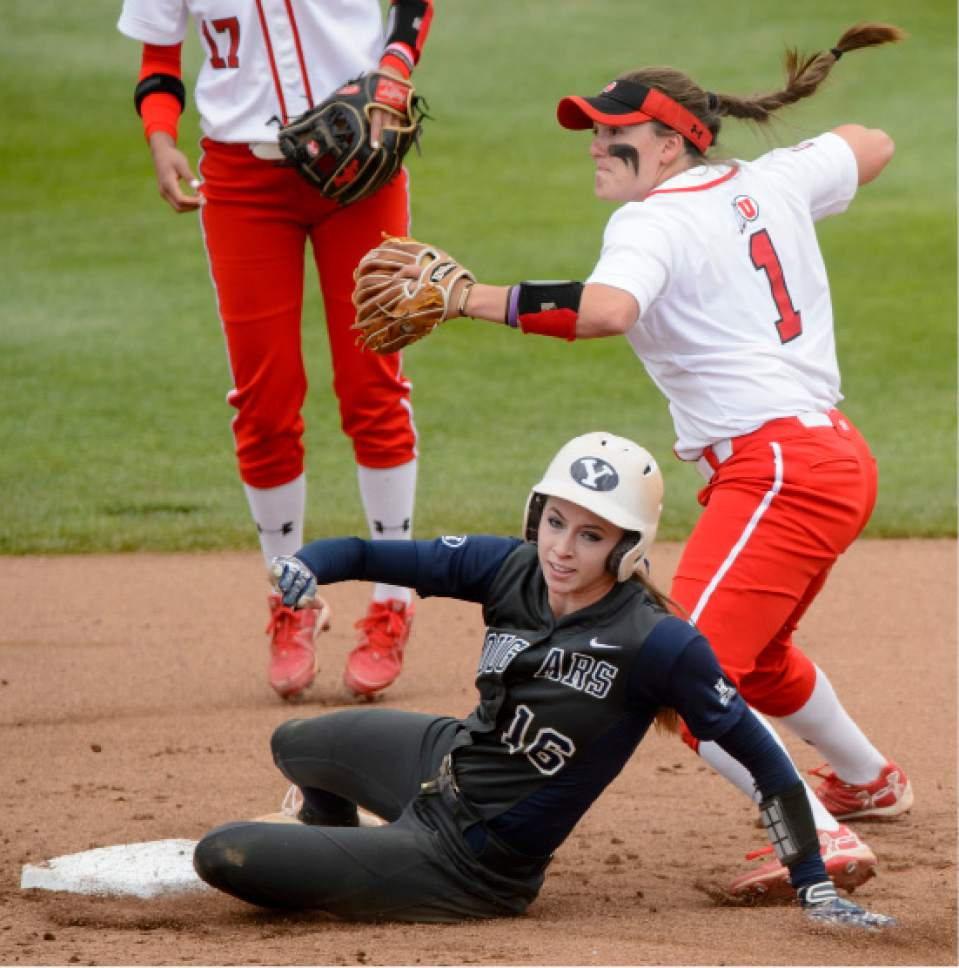 Steve Griffin     The Salt Lake Tribune    Utah second baseman Hannah Flippen looks to third after forcing out BYU's Alexa Strid during the NCAA softball regional game at Dumke Family Field at the U. of U. in Salt Lake City Friday May 19, 2017.