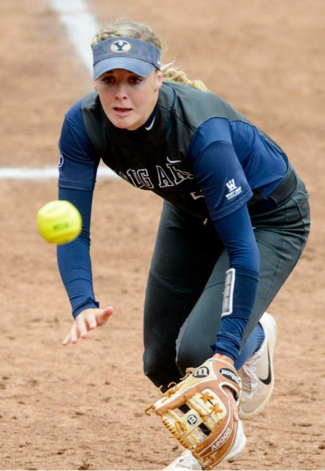 Steve Griffin     The Salt Lake Tribune    BYU's Caitlyn Larsen Alldredge charges in as she tries to catch a foul ball during the NCAA softball regional against Utah at Dumke Family Field at the U. of U. in Salt Lake City Friday May 19, 2017.