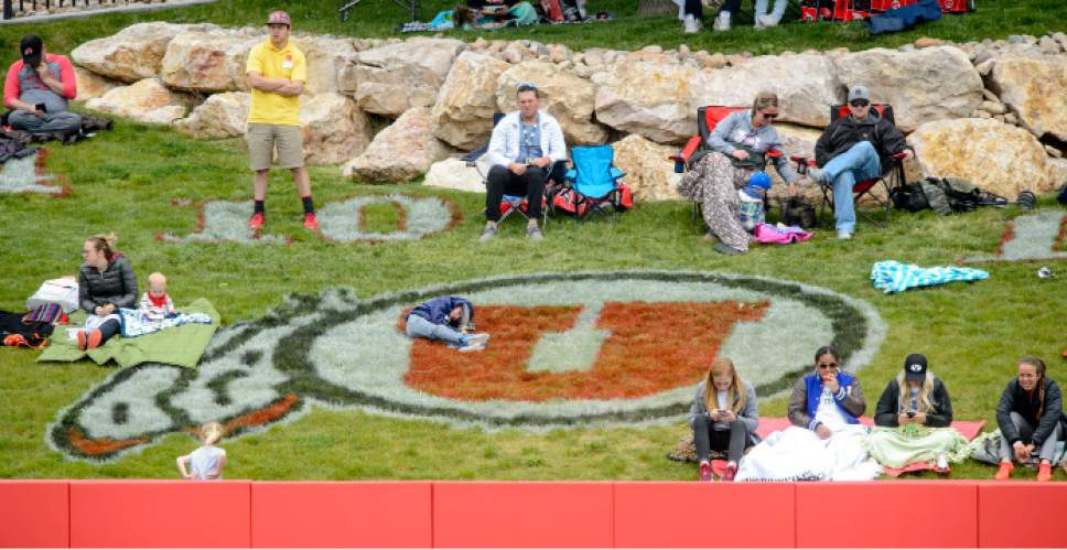 Steve Griffin     The Salt Lake Tribune    Fans sit behind the outfield fence as they what Utah battle BYU in the NCAA softball regional at Dumke Family Field at the U. of U. in Salt Lake City Friday May 19, 2017.