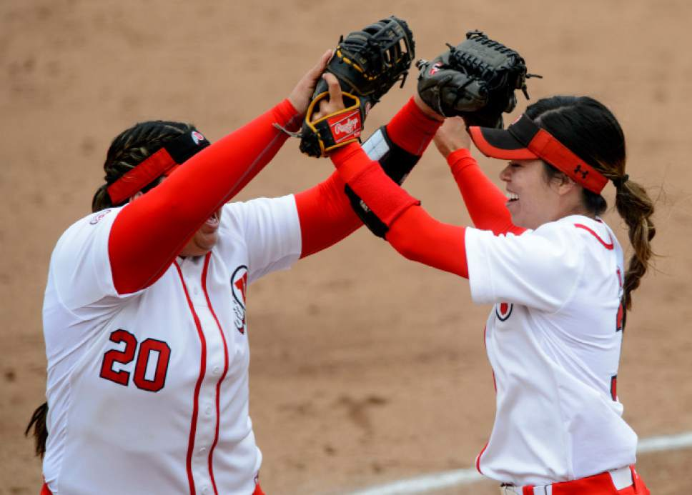 Steve Griffin     The Salt Lake Tribune    Utah' Miranda Viramontes, right, celebrates with Utah first baseman Bridget Castro after Castro completed an unassisted double play during the NCAA softball regional game against BYU at Dumke Family Field at the U. of U. in Salt Lake City Friday May 19, 2017.