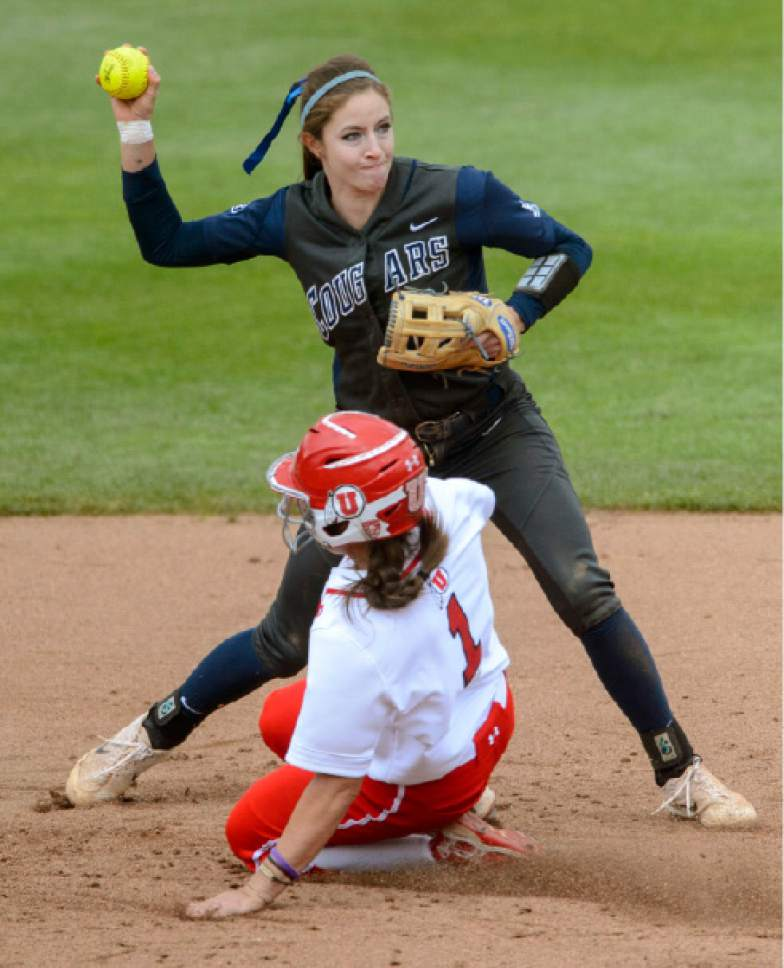 Steve Griffin     The Salt Lake Tribune    BYU shortstop Alexa Strid fires to first after forcing out Utah's Hannah Flippen and second base during the NCAA softball regional game at Dumke Family Field at the U. of U. in Salt Lake City Friday May 19, 2017.