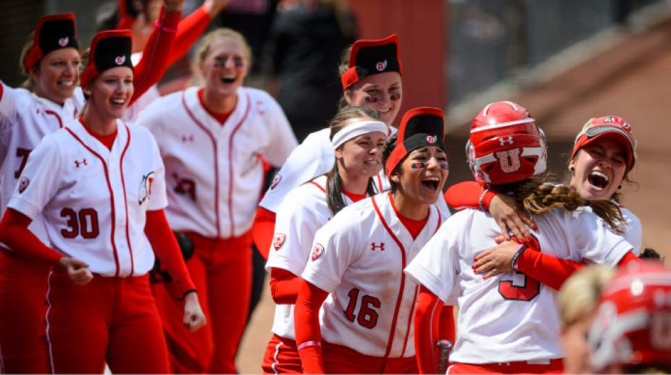 Steve Griffin     The Salt Lake Tribune    Utah players mob Bridget Castro after she scored the tying run during the NCAA softball regional game against BYU at Dumke Family Field at the U. of U. in Salt Lake City Friday May 19, 2017.