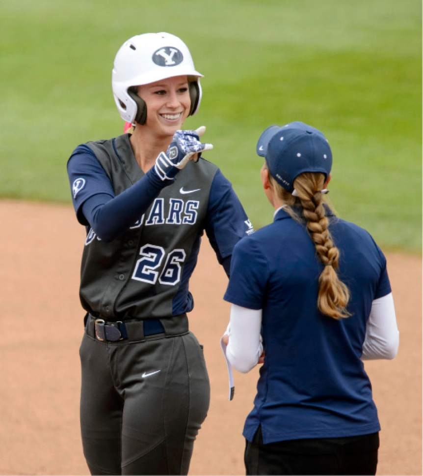 Steve Griffin     The Salt Lake Tribune    BYU's Lexi Tarrow smiles after she ripped a single in the NCAA softball regional game against Utah at Dumke Family Field at the U. of U. in Salt Lake City Friday May 19, 2017.