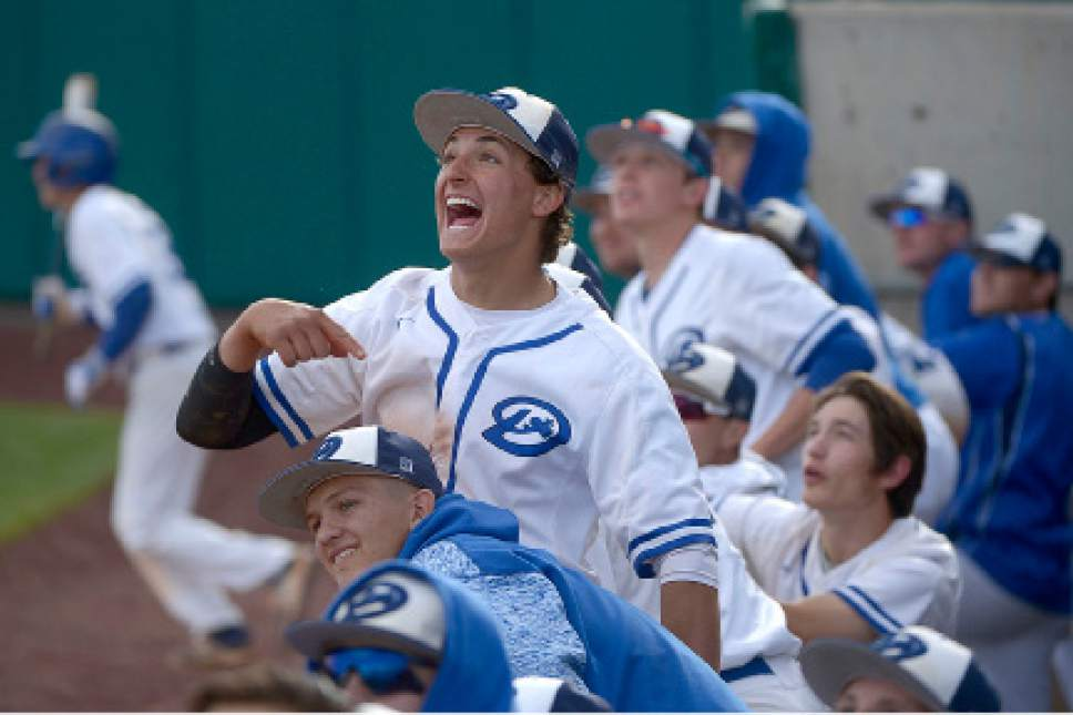 Leah Hogsten  |  The Salt Lake Tribune Dixie's Payden Harrah and the dugout react as a fly ball from Joshua Cazier brings in Trey Johnson and Jacob English. Dixie High School boys' baseball team defeated Park City High School 19-1 during their Class 3A baseball state semifinal at Brent Brown Ballpark, Friday, May 19, 2017.