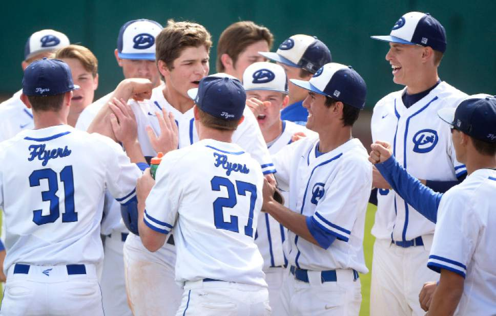 Leah Hogsten  |  The Salt Lake Tribune Dixie's Tyson Fisher celebrates his home run hit in the second with the team. Dixie High School boys' baseball team defeated Park City High School 19-1 during their Class 3A baseball state semifinal at Brent Brown Ballpark, Friday, May 19, 2017.