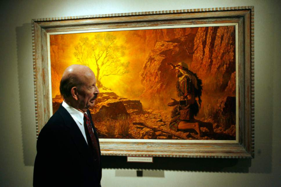"The late Utah artist Arnold Friberg with his epic paintings of biblical scenes from Cecil B. Demille's ""The Ten Commandments."" Here, in 2006, he passes by his painting called ""Moses and the Burning Bush."" Al Hartmann/photo"