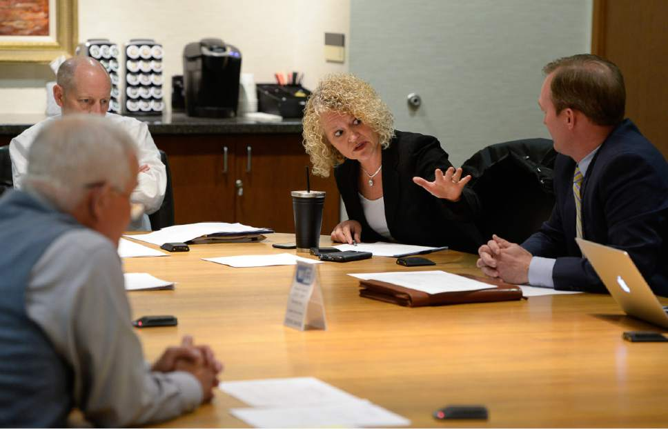 Francisco Kjolseth | The Salt Lake Tribune Salt Lake City Mayor Jackie Biskupski raises a concern as members of the private nonprofit Shelter the Homeless meet in downtown Salt Lake City to discuss the future of a local collaboration to reduce homelessness on Thursday, May 18, 2017.