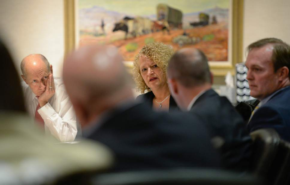 Francisco Kjolseth | The Salt Lake Tribune Lt. Gov. Spencer Cox, center right, takes note of Salt Lake City Mayor Jackie Biskupski's concerns during a board meeting of the private nonprofit Shelter the Homeless on Thursday, May 18, 2017. At left is President of the board Harris Simmons and Salt Lake County Mayor Ben McAdams at right.