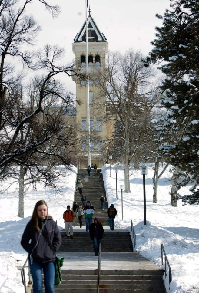Kim Raff  |  Tribune file photo A Utah State University students walk out of the Old Main on campus in Logan on February 2013. USU has added a new outdoor products degree.