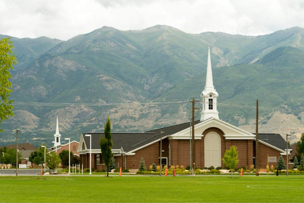 Rick Egan  |  The Salt Lake Tribune  Two LDS chapels built adjacent to each other on Angel Street, in Kaysville. Thursday, August 21, 2014.