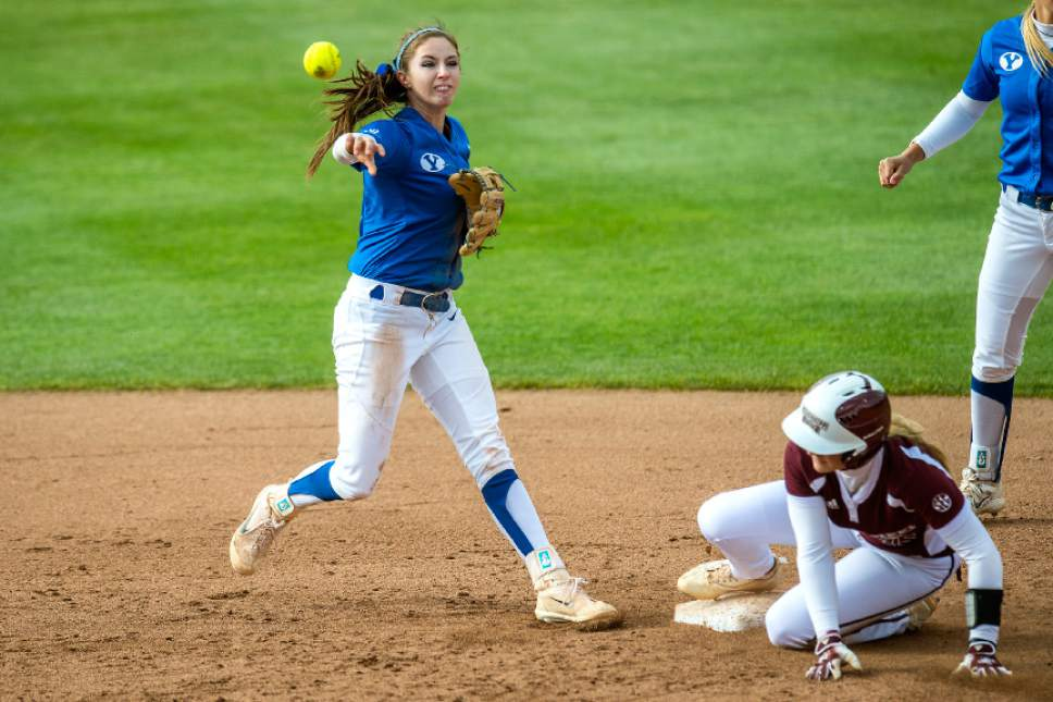 Chris Detrick     The Salt Lake Tribune BYU infielder Alexa Strid (16) throws the ball to first base after forcing out Mississippi St. infielder Caroline Seitz (15) during the NCAA softball regional game at Dumke Family Softball Stadium Thursday, May 18, 2017. BYU defeated Mississippi St. 8-0.
