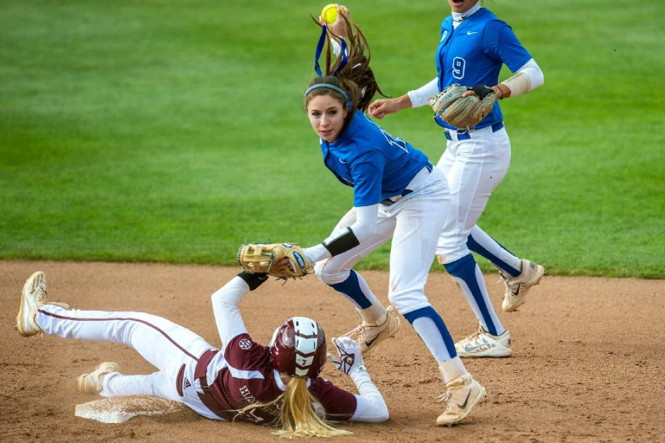 Chris Detrick     The Salt Lake Tribune BYU infielder Alexa Strid (16) jumps over Mississippi St. infielder Reggie Harrison (7) after forcing her out at second base. during the NCAA softball regional game at Dumke Family Softball Stadium Thursday, May 18, 2017. BYU defeated Mississippi St. 8-0.