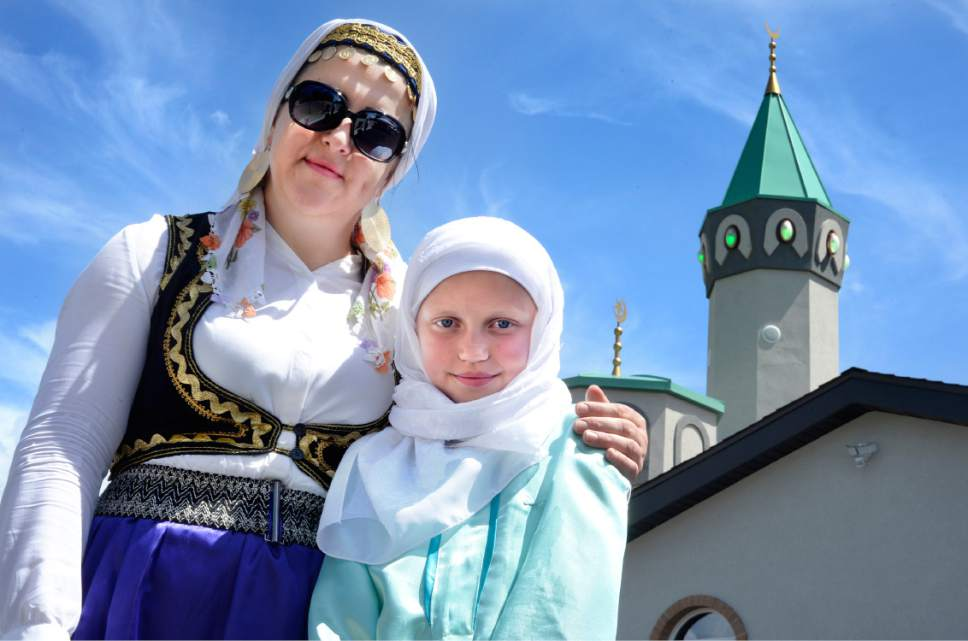 Scott Sommerdorf | The Salt Lake Tribune Mersiaj Kadic, left, and Selma Kisija pose for a portrait in front of the renovated Maryam Mosque Saturday during the celebration of its grand opening at 425 N. 700 East. The day featured tours, music, authentic Bosnian food in celebration of the completion of the extensive remodeling of the mosque by the Islamic Society of Bosniaks in Utah.