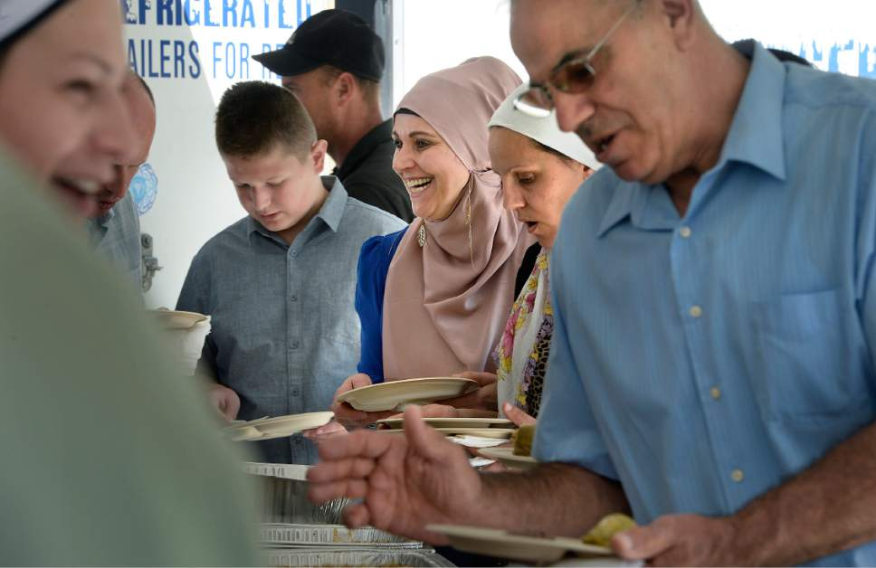 Scott Sommerdorf | The Salt Lake Tribune Semna Mehmebovic smiles as she goes through the food line Saturday during the grand opening celebration of the Maryam Mosque at 425 N. 700 East. The day featured tours, music, authentic Bosnian food in celebration of the completion of the extensive remodeling of the mosque by the Islamic Society of Bosniaks in Utah.