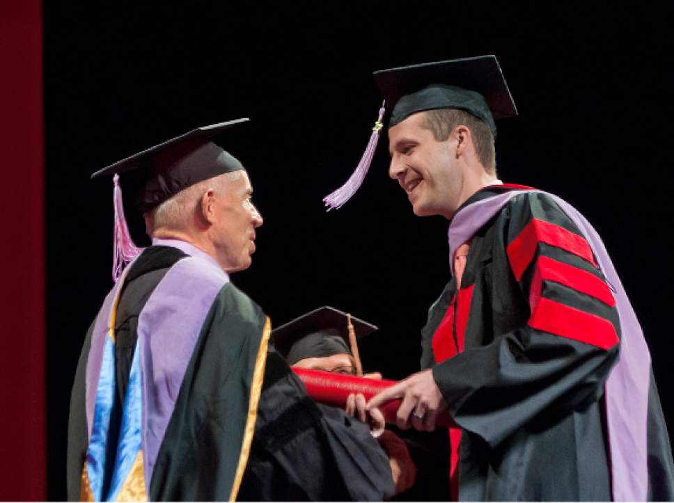 Michael Mangum  |  Special to the Tribune Associate Dean Glen R. Hanson presents Gabriel Dickes with his diploma during the University of Utah School of Dentistry inaugural commencement ceremonies at Kingsbury Hall on Saturday, May 20th, 2017.